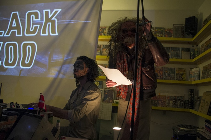 Writer Owen Michael Johnson performs with Karlsnarl & The Animatones at Beast Wagon exhibition and Kickstarter launch in Orbital Comics London