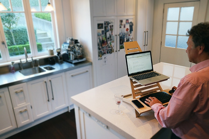 "John uses his laptop throughout the home. ""No more mouse shoulder"" since he's been using the Elevate."