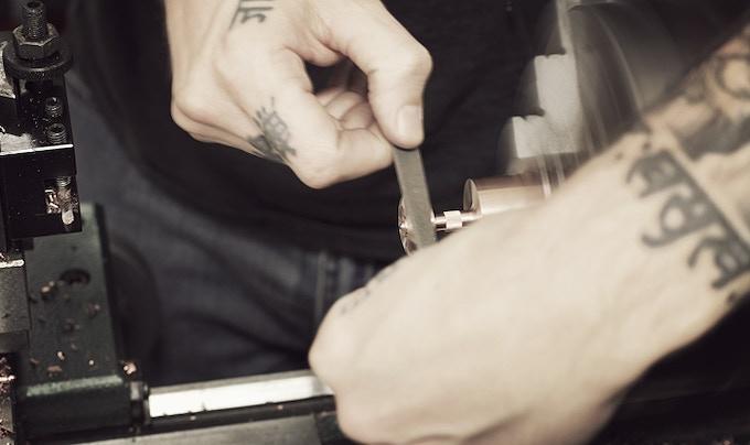 Filing to break sharp edges