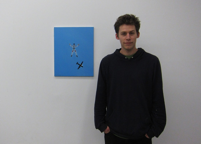 This is me standing next to one of my paintings