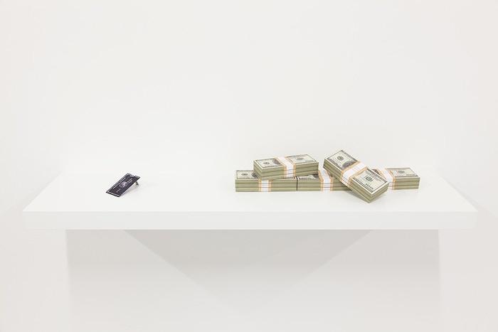 Anthony Antonellis, #Moneybrick Centurion Card, installation view, 2014. American Express Centurion USB Card.