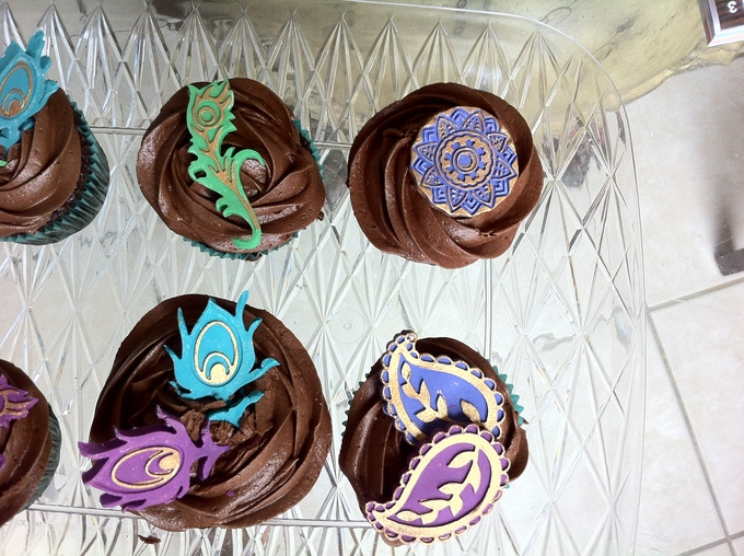 Pre made fondant decorations to choose from.Golden embellishment optional.