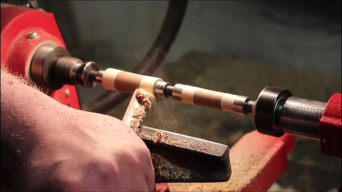 Turning the blank down using a lathe