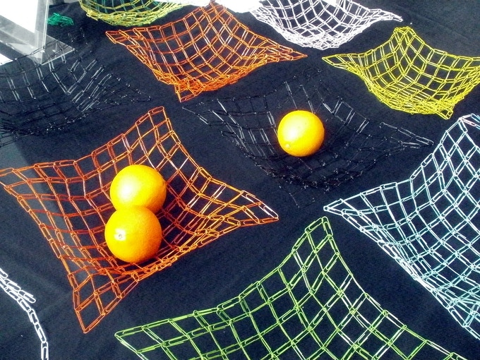 Black, orange, yellow, pink, lime green and turquoise coloured paperclip fruit bowls.