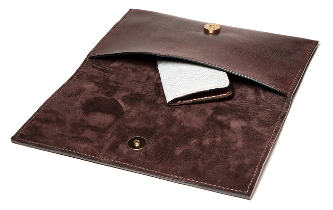 Brown leather clutch with wolffish decoration and brown suede interior