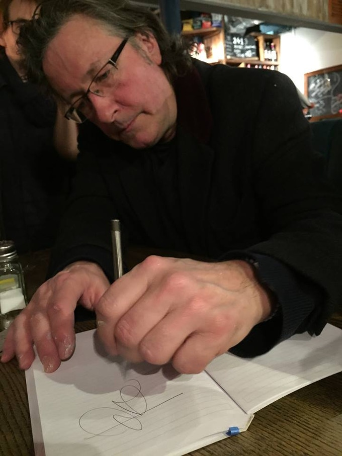 Writer and Comedian Rowland Rivron relishing his new stainless steel mechanical pencil