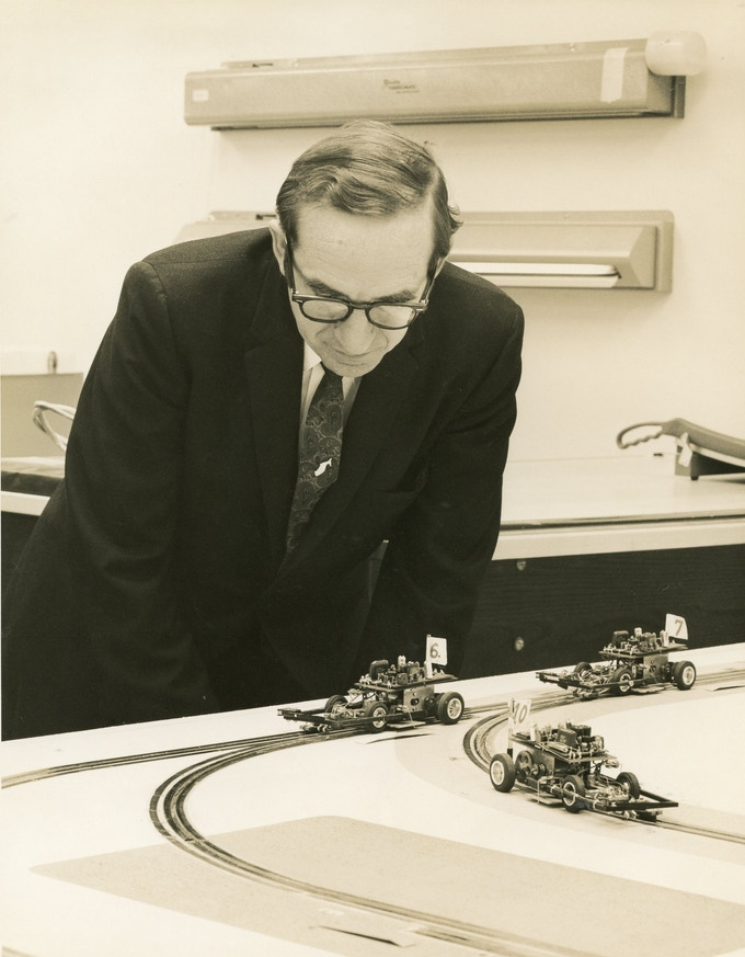 Alden inspects a working prototype of the Morgantown PRT system