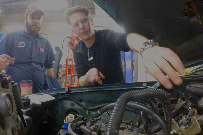 Chad and Joe making room for the fuel injection system