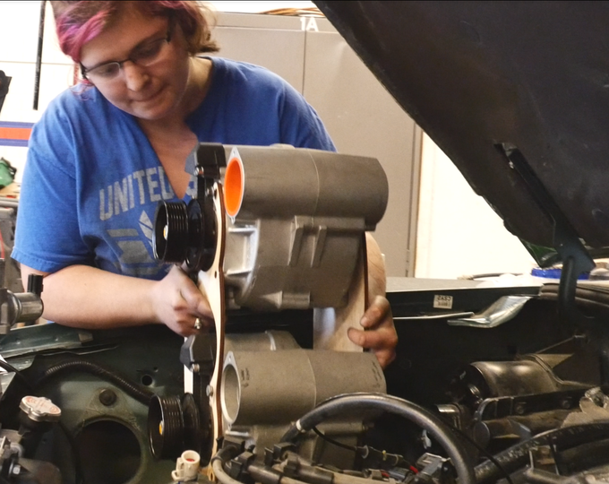 Jessica checking the fit of the dual super charger assembly