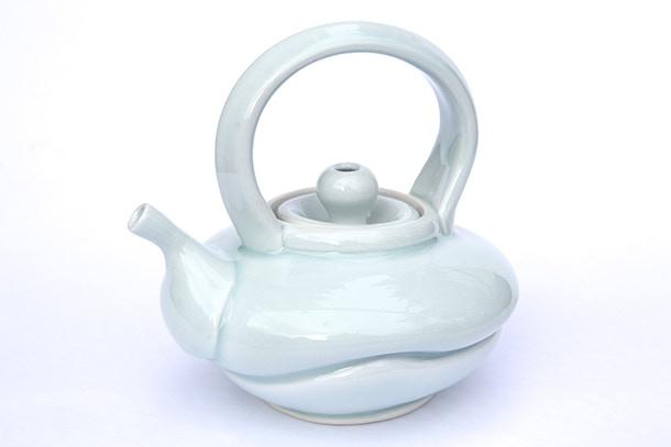 "Laura Rasmussen, Porcelain Teapot with Celadon Glaze, 10x7"" $150"