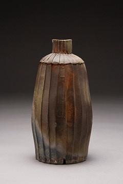 """Trent Burkett, Faceted Bottle 3x8x8"""" $450"""