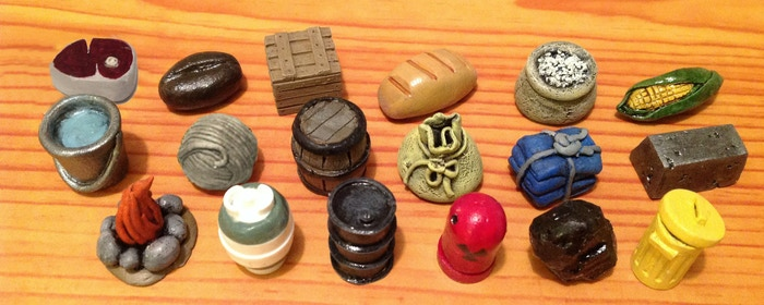 The dimensions of each token are a little over 1 cm (height, width, length).