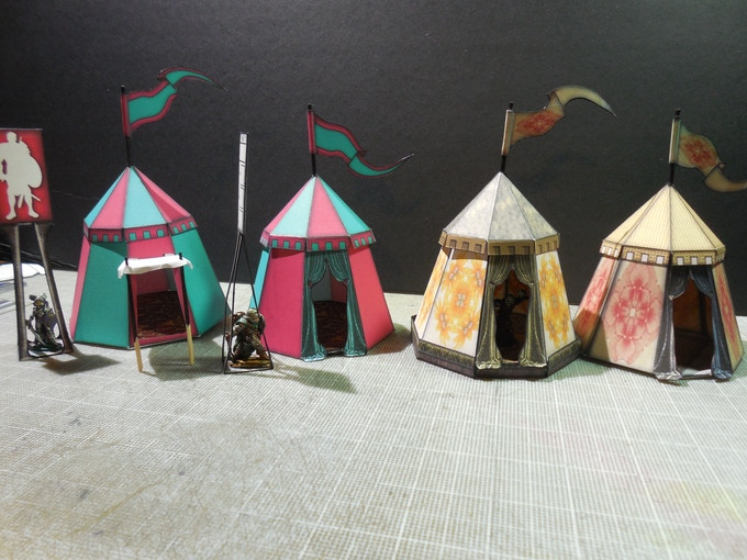 "These are the Small Knight's Tents.  The yellow one is sitting on a 1/4"" foam core base.  These are the practical models."