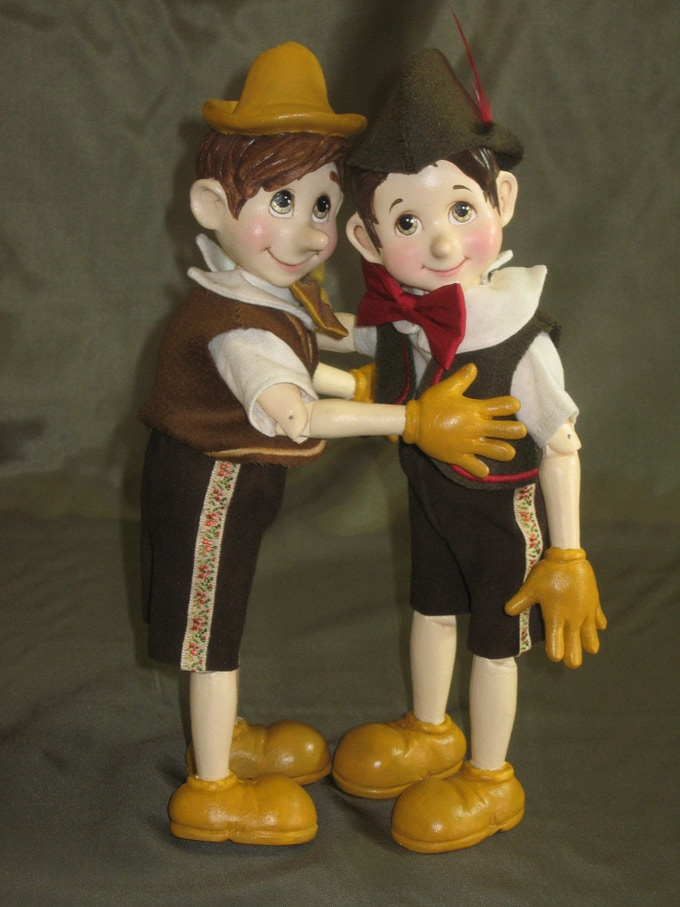 """Our two Pinocchios - Both  10 1/2"""" tall with moveable joints & head."""