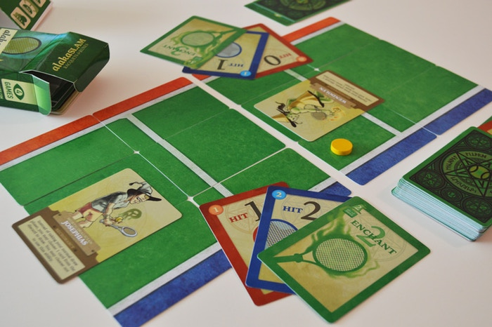 AlakaSLAM is a 2 or 4 player micro card game: a tennis match, spiced up with magic, and folded up into one small box.