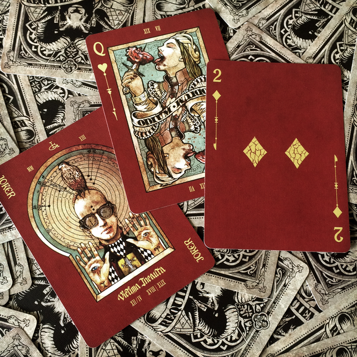 Requiem custom playing cards deck printed by USPCC- A dark deck with red background with illustrated courts, jokers and aces.