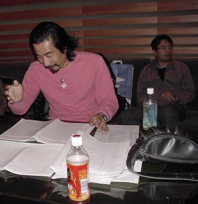 Composer Kow Otani (foreground) and Director Shusuke Kaneko (background). Photo Courtesy Norman England.