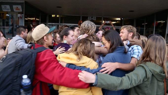 A group hug and a skycall to end the concert.