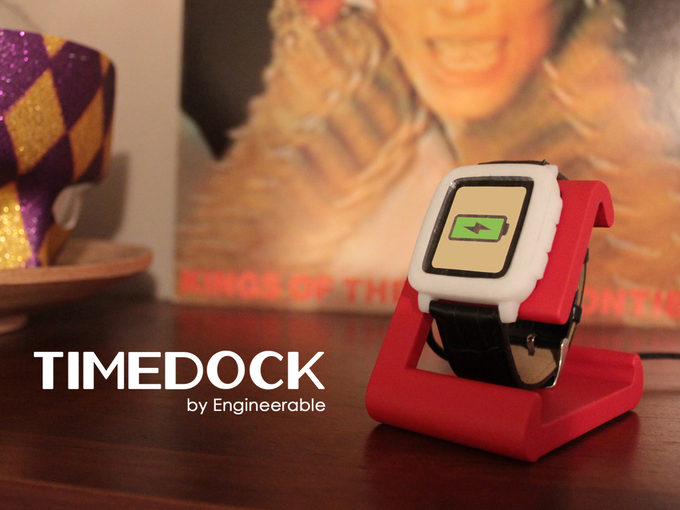 Photo of TimeDock prototype in Red with Pebble Time model