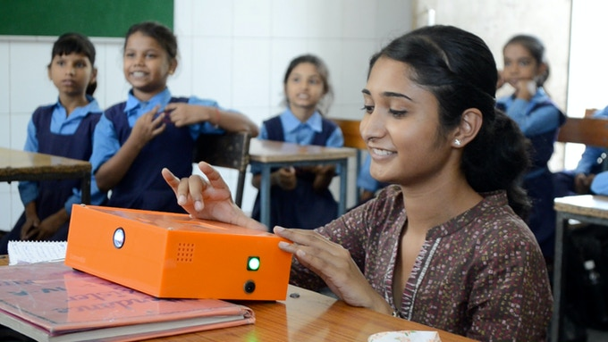 Joanna uses the Bright Orange Box to play digital media in her classroom which lacks access to electricity and internet
