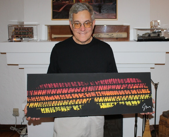 "Bob Gale showcasing his own Joe Walser 15""x40"" canvas painting."