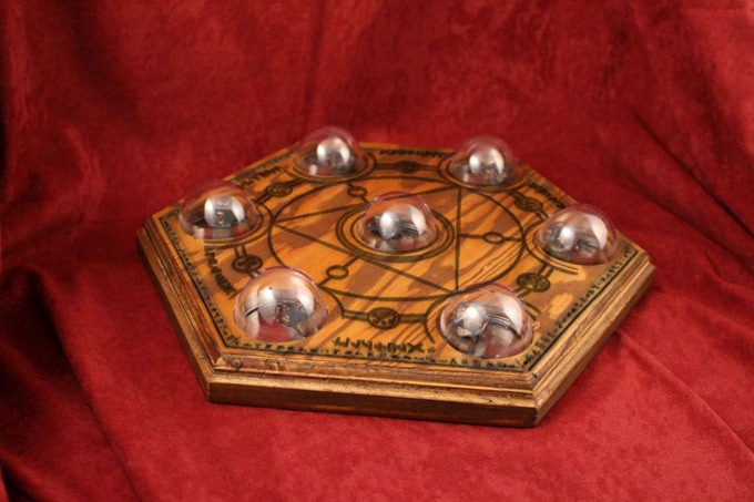 An engraved version of the Seven Dome Dice Board
