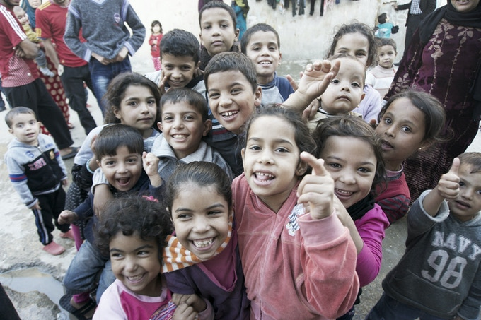 """Children shouting """"We want school!"""""""