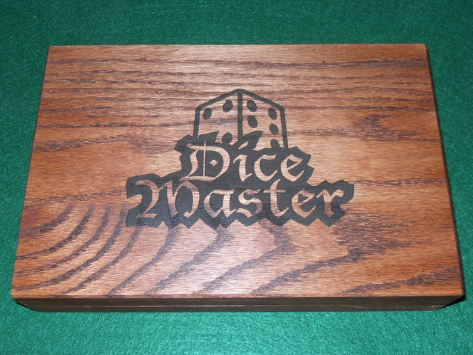 Here is an example of a Box with Red Oak stain and the Laser engraving add-on with the Dice Master logo.
