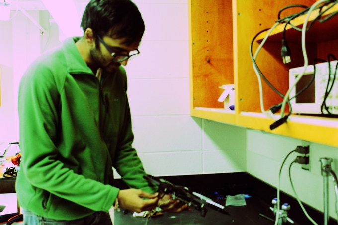 The co-founder, Ritwik, fiddling with a quadcopter