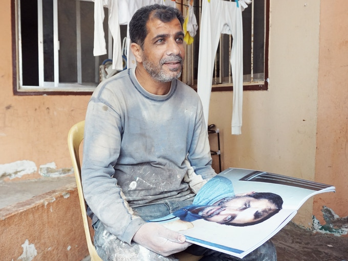 """Ghanem, seeing his picture in """"Migrants of Circumstance"""" for the first time"""