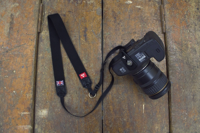 Slidestrap holds your camera ergonomically against your body and allows you to bring your camera to eye level without strap adjustment