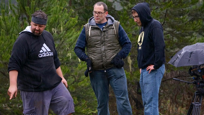 """Shooting """"The Device"""" (pictured left to right) Matt, Jeremy and John worked rain or shine... but mostly rain."""