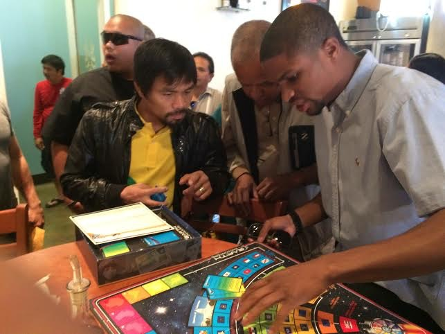 (Manny Pacquiao learning how to play Earth Encounters)