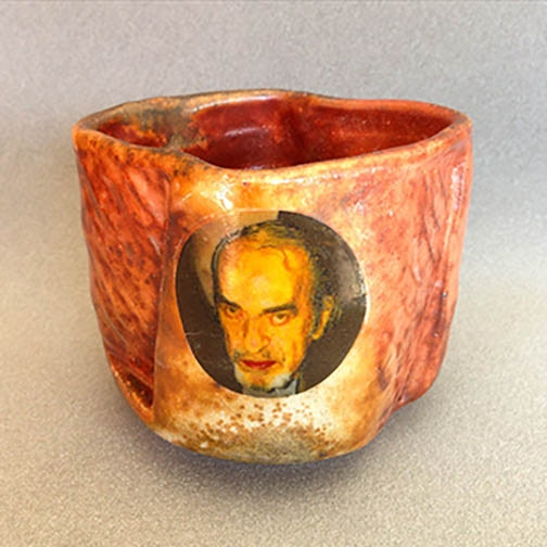 """Daniel Anderson, """"Pete"""" Teabowl, 3.25x4x4"""" Woodfired in Chris Gustin's Anagama, decal fired to cone 017 $100"""