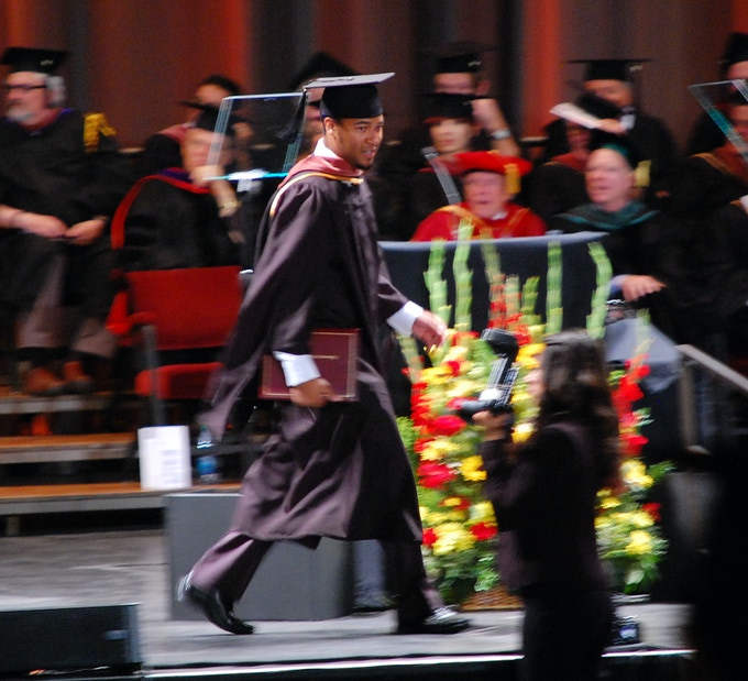 Justin struts 'cross 'dat stage at USC.