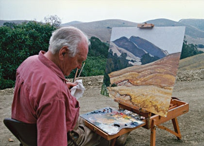 Ray Strong, painting at his easel