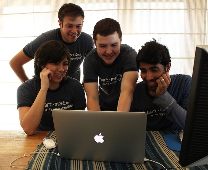 The a•part•ment team in their natural habitat — in front of a computer screen.