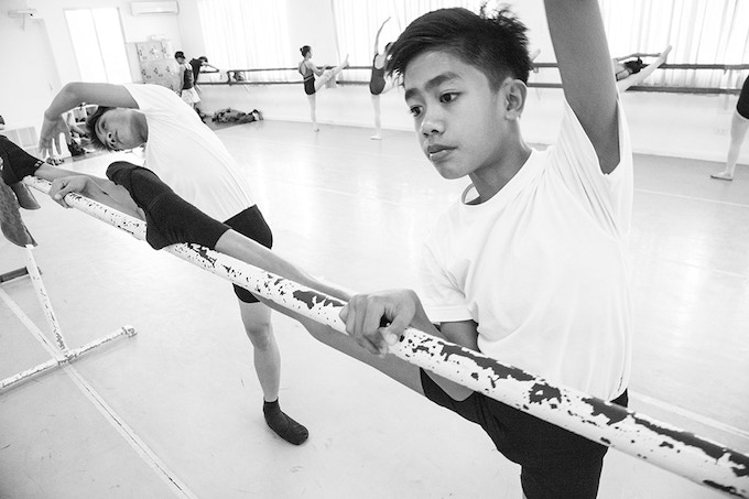 Ballet scholars Benedict and Edmar doing their stretching exercise
