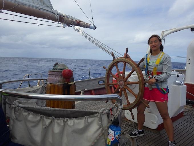 Me steering the brigantine SSV Corwith Cramer through the North Atlantic