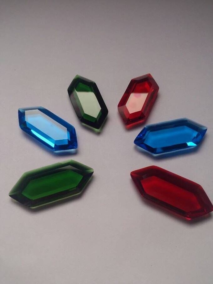 44mm x 18mm x 7mm:  Green, Red, Blue, Yellow, Orange, Purple, Opalite, Black, and Clear.  Gems are laser cut from a solid piece of AAA grade glass and hand polished to finish.