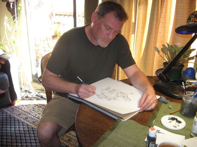 Ross Adams busy working on Pinocchio drawings