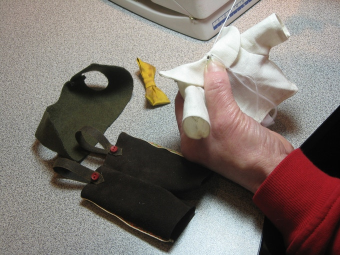 Some hand sewing for the little Pinocchio outfit
