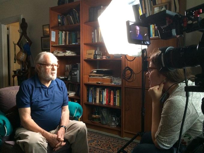 Kahane interviewing Joseph in his apartment.