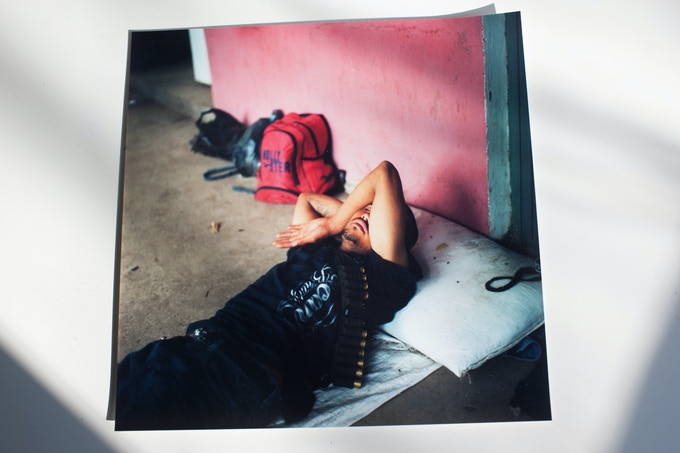 """Sleeping vigilante fighter. Brett Gundlock. 2013. 8x8"""" Digital C-Print."""