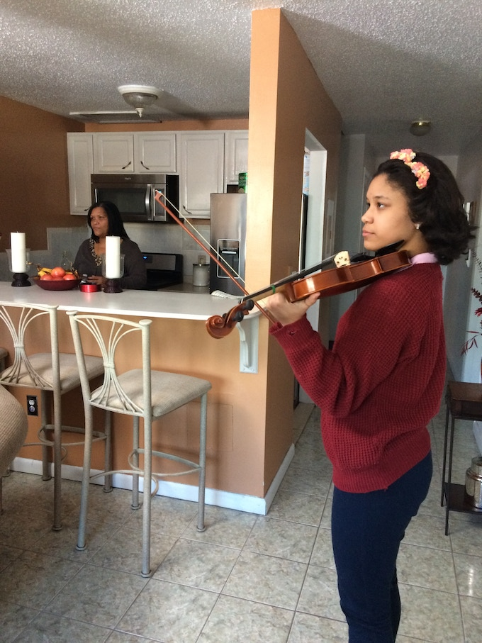 Brianna practices while her mom makes dinner.