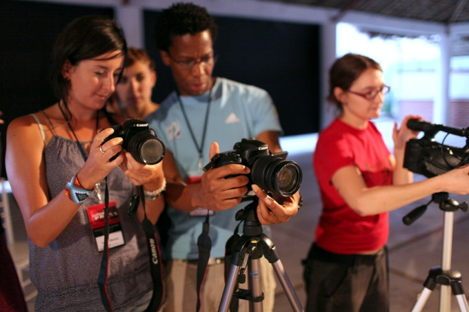 Filming a plenary session during the School of Authentic Journalism 2011.