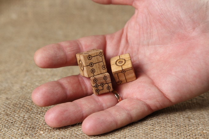 Visualization of wooden dice. Warm and pleasant to the touch material - oak.