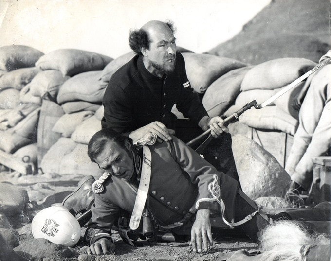Dickie Owen as Corporal Scheiss in 'ZULU'