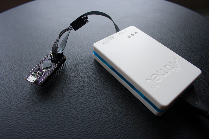 The Neutrino can be programmed with the Arduino IDE, or a JTAG programmer, like the Atmel ICE!