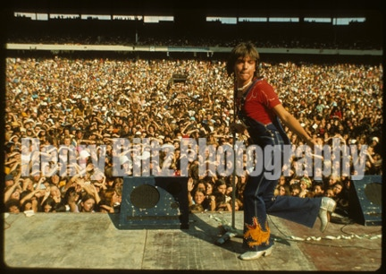From the Henry Diltz archives, this unique shot of David Cassidy is printed at 11 X 14 and captures the crowd in the background! It was taken on March 10, 1974 at the Melbourne Cricket Grounds! An exclusive premium for our campaign, signed by Henry Diltz!